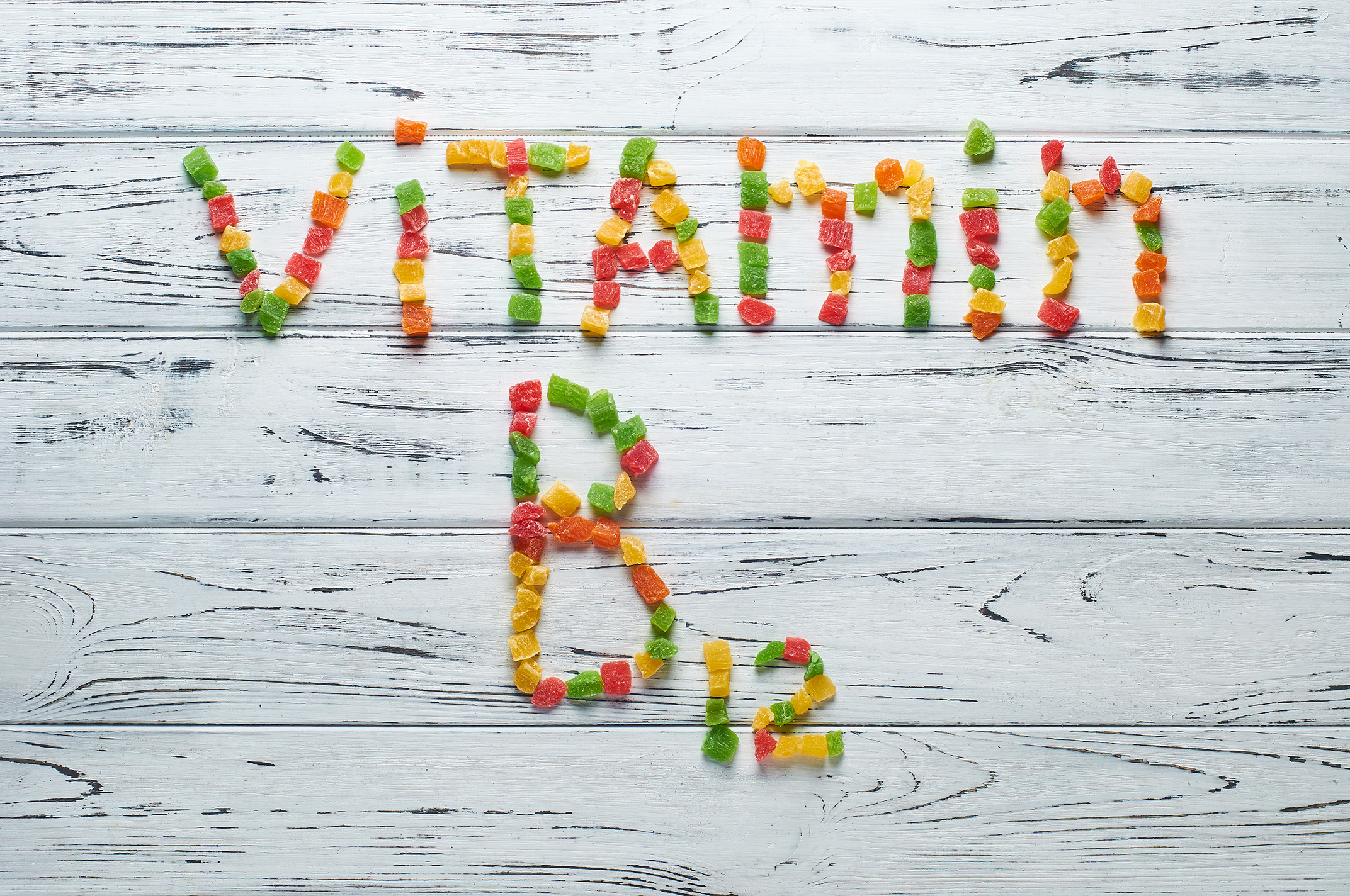 The word vitamin B12 written pieces of candy.